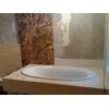 Travertine and marble bathtub surround